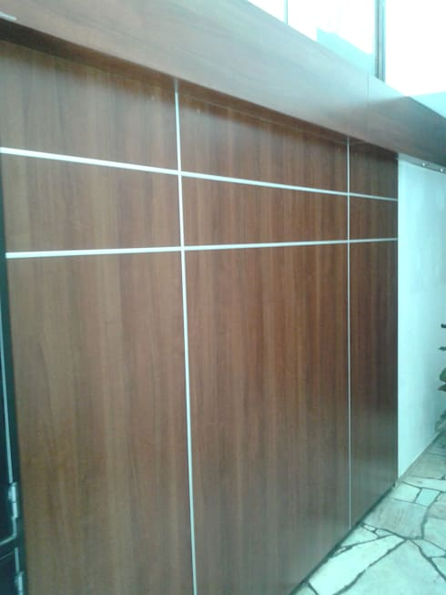 Pasillos y hall de entrada de estilo  por fg arquitectura