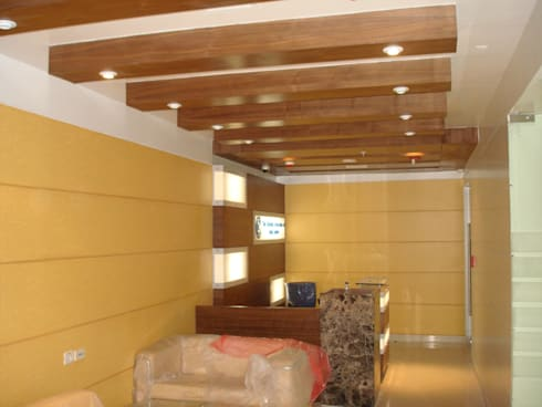 reception : classic Study/office by Mithi Interiors Private Limited