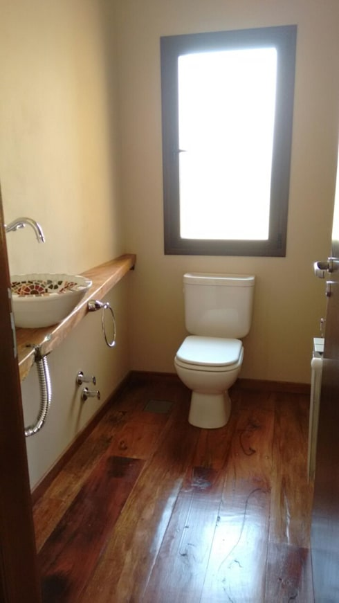 Baños de estilo rústico por Abitar arquitectura