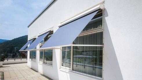 Sonnenschutz für Firmengebäude: klassische Häuser von Markisen Zanker
