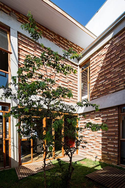 Jardines de estilo moderno por Grupo Garoa Arquitetos associados