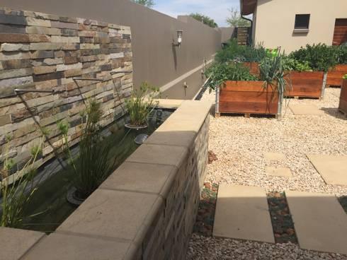 Water feature focal point in kitchen garden: country Garden by Acton Gardens