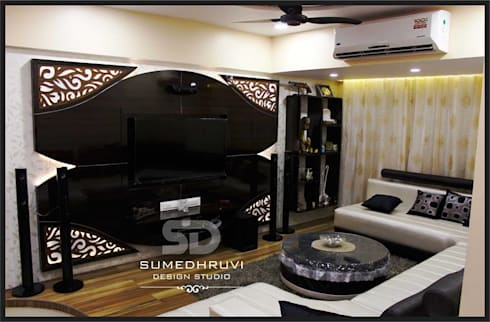 T.V. Unit with Shelves: modern Living room by SUMEDHRUVI DESIGN STUDIO