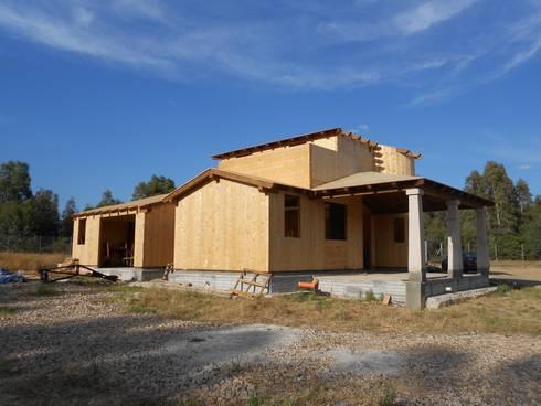 Realizzazione casa in bioedilizia costruita in legno con for Casa costruita
