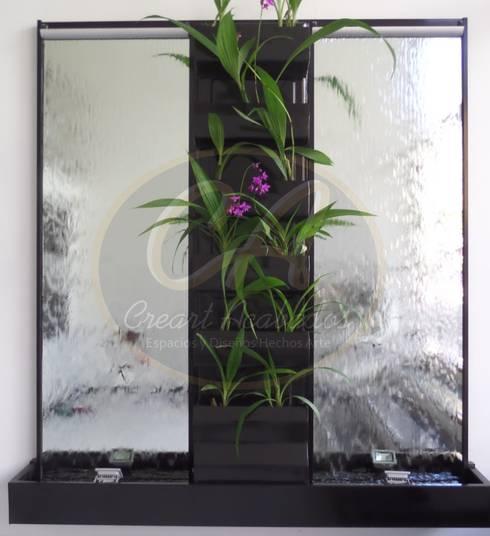 Espejos de agua con muro verde central: Paisajismo de interiores de estilo  por Creart Acabados