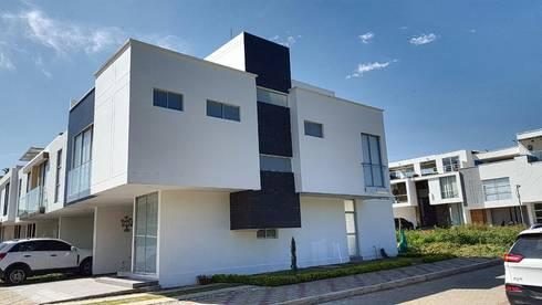 casas  punta colorados: Casas de estilo minimalista por CONSTRUCTOR INDEPENDIENTE
