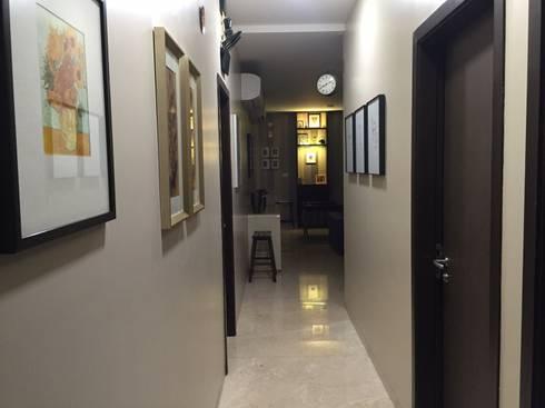 Private Reisdence—3bhk apartment:  Corridor & hallway by One sq. meter Architects & Interior Designers