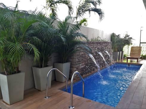 Casa modelo Cerdeña – Novaterra Ocean City: Jardines de estilo tropical por ecoexteriores