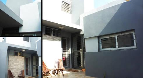 Casa M-1216: Casas de estilo moderno por ELVARQUITECTOS