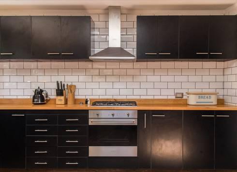 modern Kitchen by RENOarq