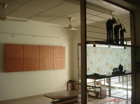 A retreat Apartment Living Space: modern Living room by MRJ ASSOCIATES