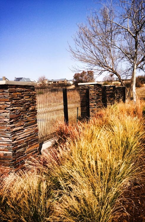 Framing the view with soft grasses: country Garden by Acton Gardens