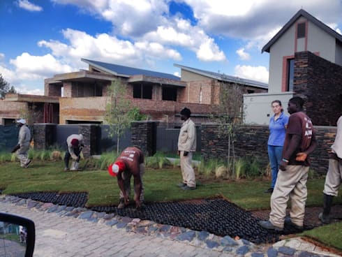 Lawn getting laid on the modern grass blocks - protected lawn parking area:   by Acton Gardens