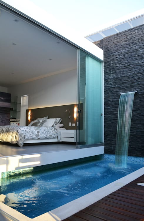 Jacuzzi y Dormitorio Principal: Piscinas de estilo moderno por DMS Arquitectas