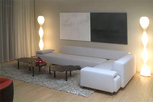 Moderno: Salas de estilo moderno por Claudia Luján