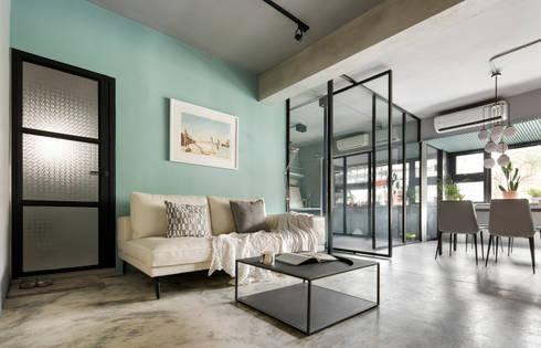 將材質做為空間呼應的主軸:  客廳 by 磨設計