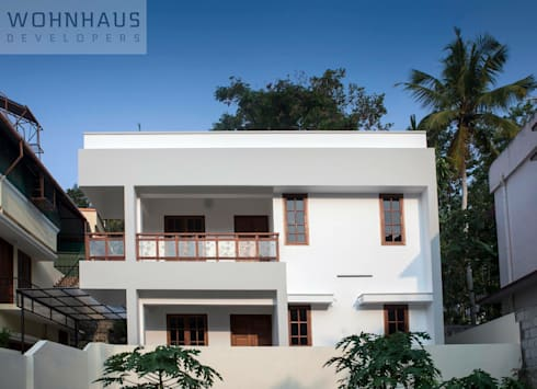 1400sqft House in Trivandrum: modern Houses by Wohnhaus Developers
