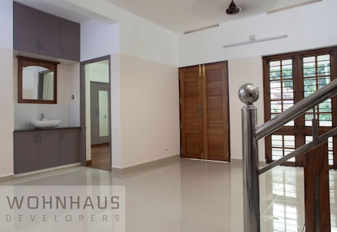 1400sqft House in Trivandrum:  Corridor & hallway by Wohnhaus Developers