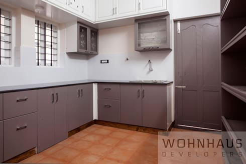 1400sqft House in Trivandrum: modern Kitchen by Wohnhaus Developers