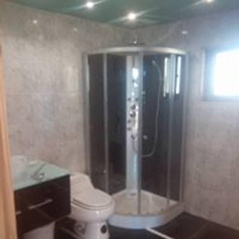 casa campo: Baños de estilo rural por construcciones costa