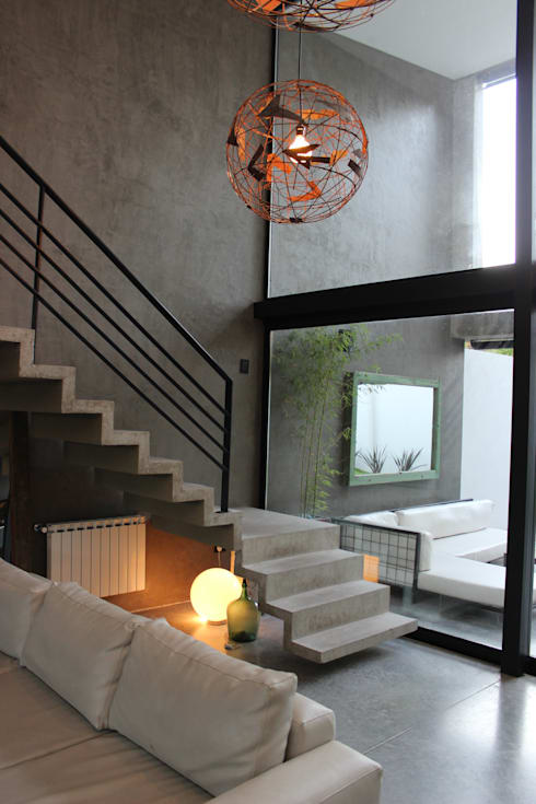 VIVIENDA UNIFAMILIAR: Livings de estilo moderno por DUA Arquitectos