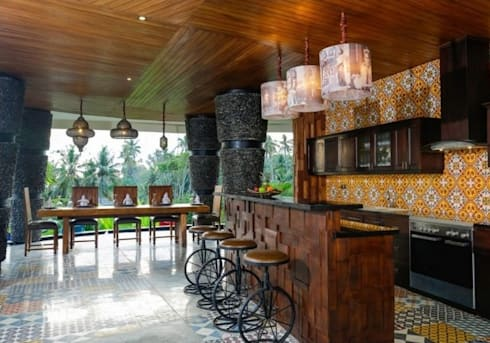 eclectic stool and printed lamp shade:  Kitchen by Credenza Interior Design