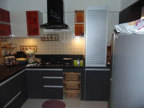 IMPERIUM BALEWADI: modern Kitchen by decormyplace.com