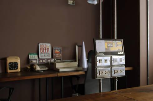 如咖啡廳的復古工業風辦公室:  辦公室&店面 by 哲嘉室內規劃設計有限公司