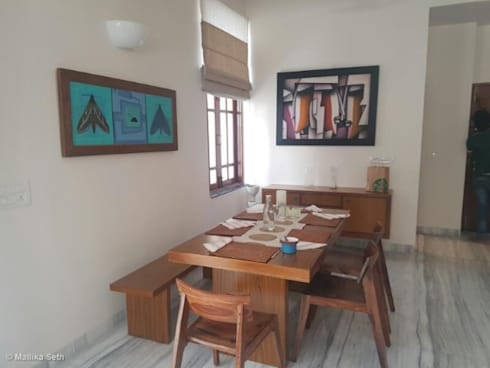 Renovation & Interiors for a Duplex Apartment: modern Dining room by Mallika Seth