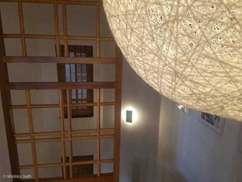 Renovation & Interiors for a Duplex Apartment: modern Corridor, hallway & stairs by Mallika Seth