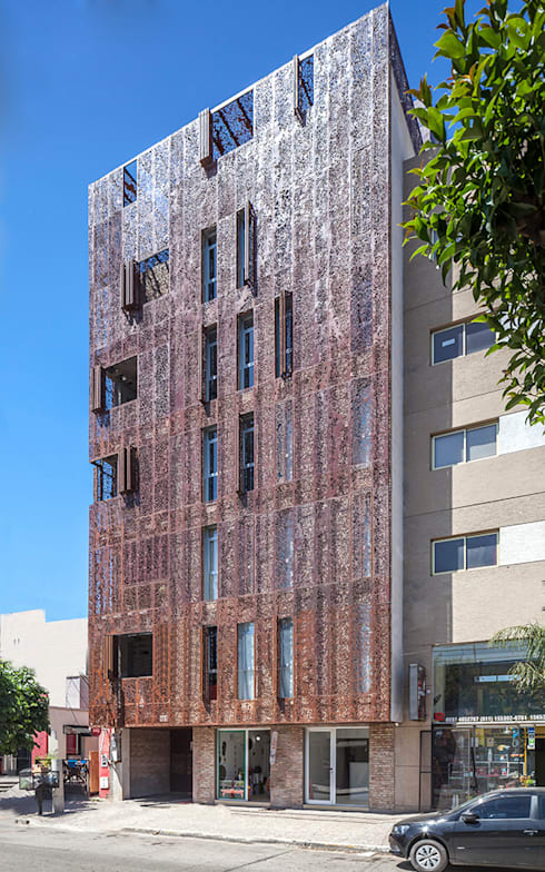 VV Building: Condominios de estilo  por Ciudad y Arquitectura