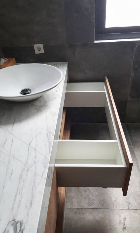 A House:  Bathroom by KOMA living interior design