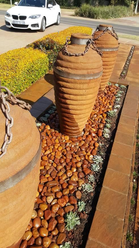 Pebbles:   by SOJE Interior, Design and Decor PTY (Ltd)
