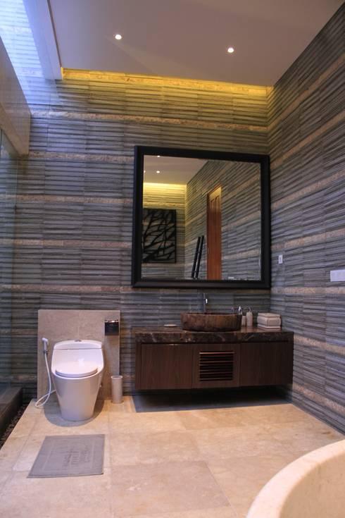 Lavatory and closet area master bathroom:  Bathroom by Kottagaris interior design consultant