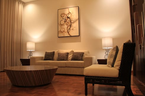 Cozy looks sofa and table:  Living room by Kottagaris interior design consultant