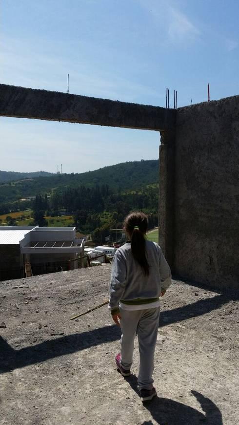 CASA CRUZ SANTELICES: Casas unifamiliares de estilo  por AOG SPA