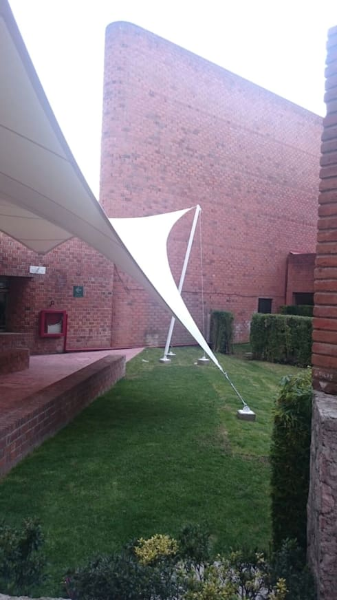 Velaria en Universidad: Casas de estilo  por Materia Viva S.A. de C.V.