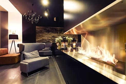 Fireplaces by Planika: modern Living room by Spacio Collections