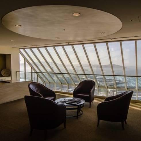 interior designers in pune:  Balconies, verandas & terraces  by Oxedea Interiors