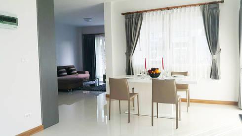 บ้านเดี่ยว สไตล์โมเดิร์น:  ห้องทานข้าว by บริษัท ถาวรเจริญทรัพย์ จำกัด