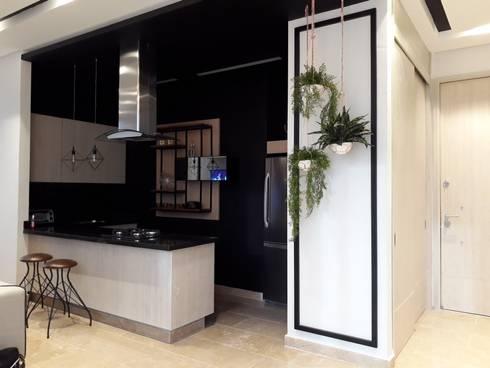 Diseño interior apartamento de soltero: Cocinas de estilo industrial por ecoexteriores
