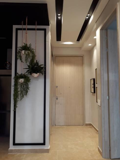 Diseño interior apartamento de soltero: Pasillos y vestíbulos de estilo  por ecoexteriores