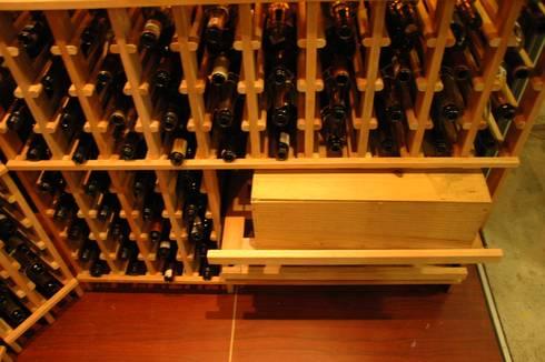WINE CELLAR:  Ruang Penyimpanan Wine by AWDS Interior