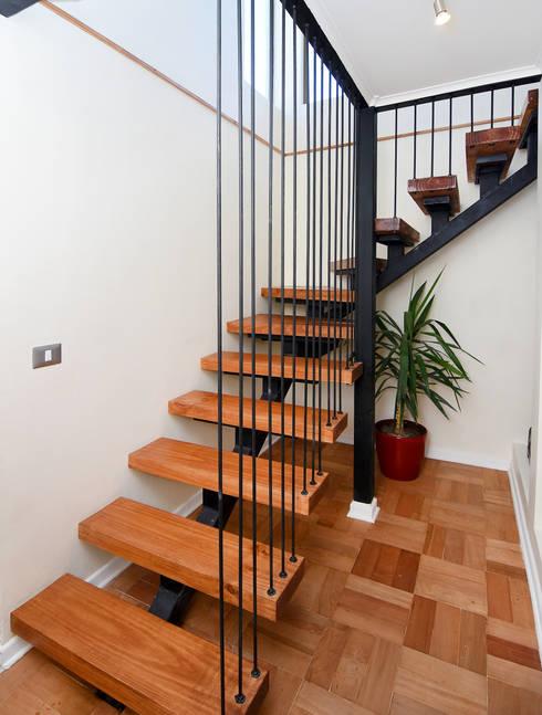 Remodelación Casa Soler: Pasillos y hall de entrada de estilo  por ARCOP Arquitectura & Construcción