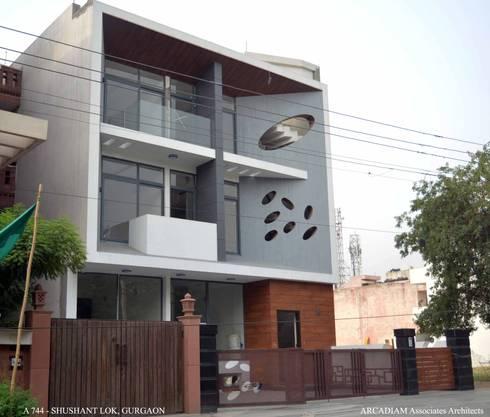 A-744: modern Houses by M/s ARCADIAM Associates Architects