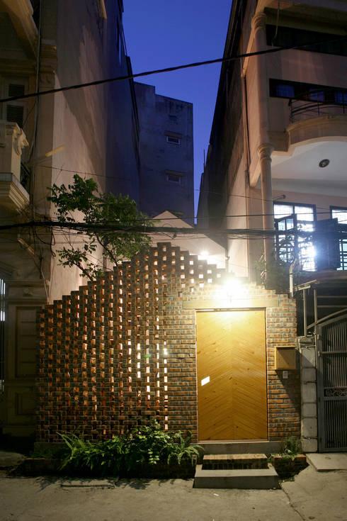 Maison T:  Nhà by NGHIA-ARCHITECT