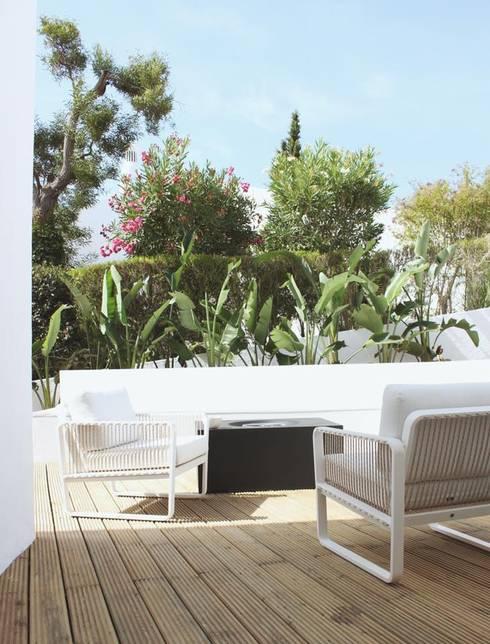 Terrace house by ECOSSISTEMAS; Áreas Verdes e Sistemas de Rega.