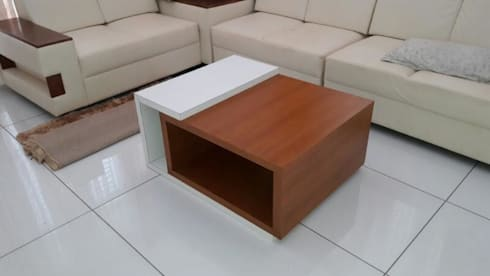 coffee table at family living:   by shabin
