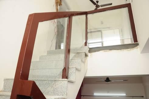 Residential Interior:  Corridor, hallway & stairs  by Azhagu Interior