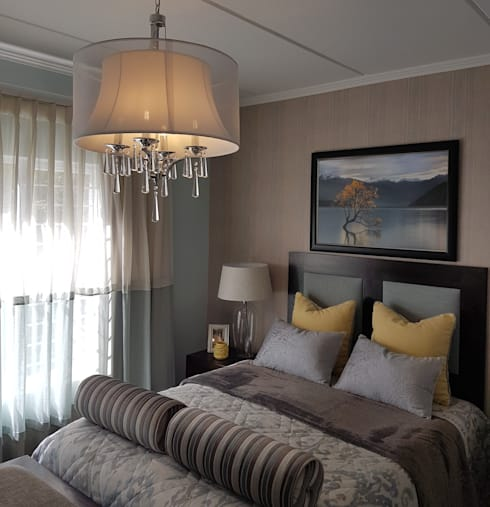 A hint of golden yellow: modern Bedroom by Sophistique Interiors